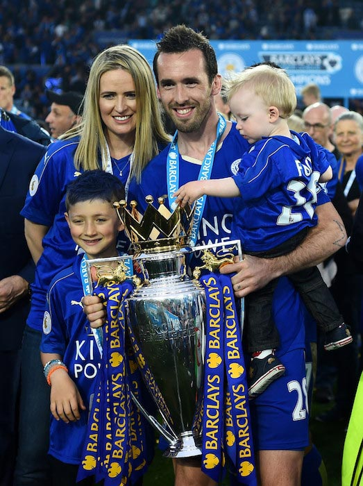 Christian Fuchs with his family taking a picture after the Premiere League match between Leicester City and Everton on May 7, 2016