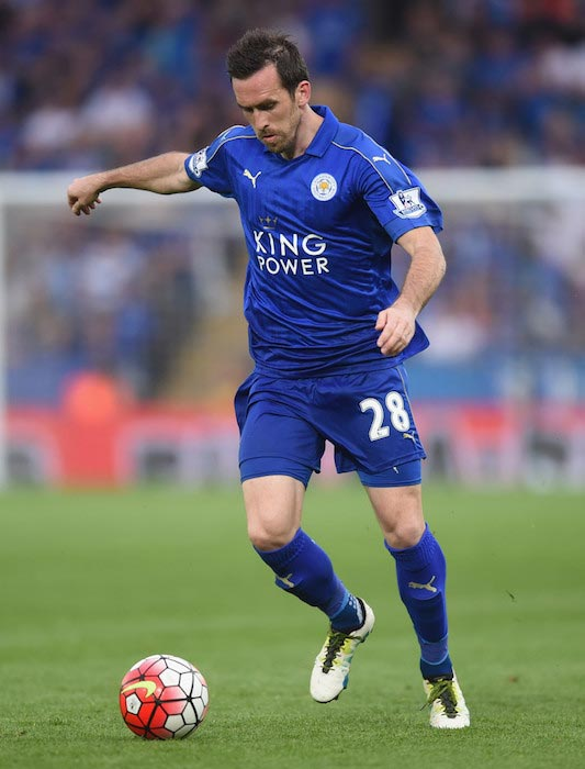 Christian Fuchs handling the ball during a match between Leicester City and Everton on May 7, 2016