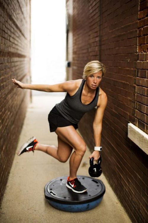 Erin Oprea working out with kettlebell