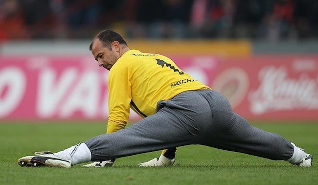 Gabor Kiraly doing his pre-match stretching