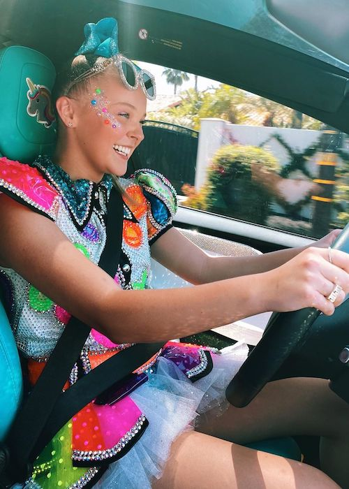 Jojo Siwa in action driving a car in August 2020
