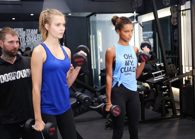 Josephine Skriver and Jasmine Tookes doing bicep curl at Dogpound