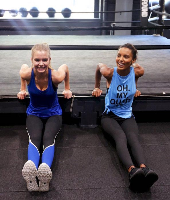 Josephine Skriver and Jasmine Tookes doing dips at Dogpound