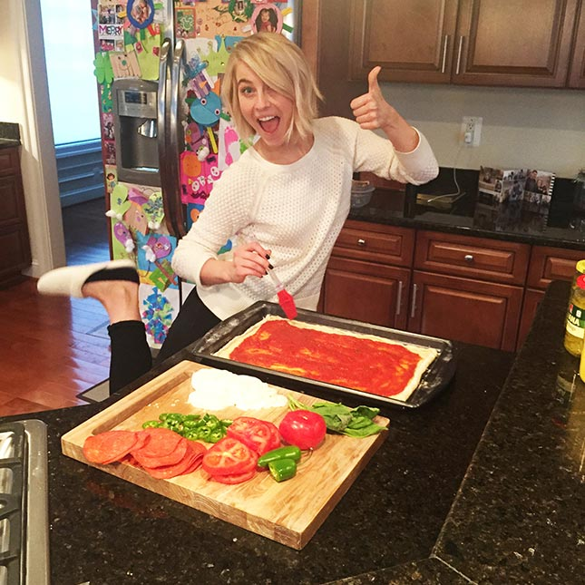 Julianne Hough making her food in the kitchen