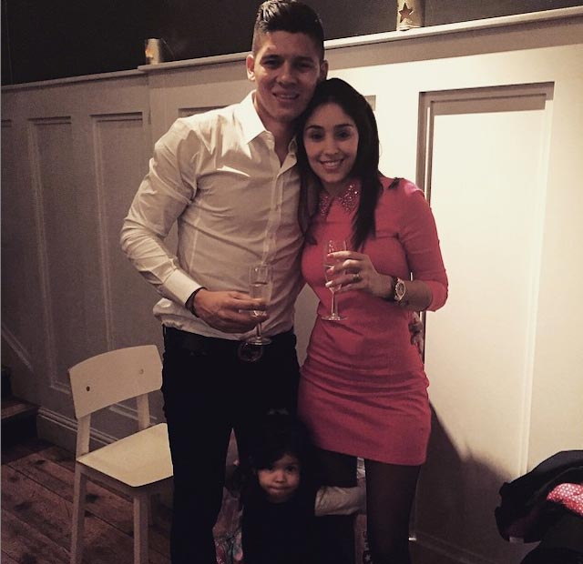 Marcos Rojo with his wife Eugenia and daughter Morena