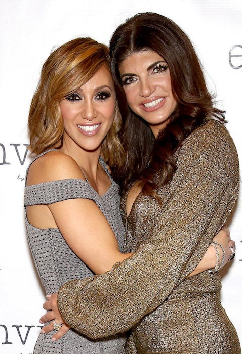 Melissa Gorga and Teresa Giudice at the first fashion show for Envy by Melissa Gorga at Macaluso's in Hawthorne, New Jersey on March 30, 2016