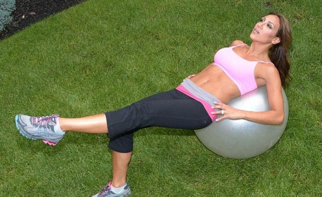 Melissa Gorga working out on an exercise ball