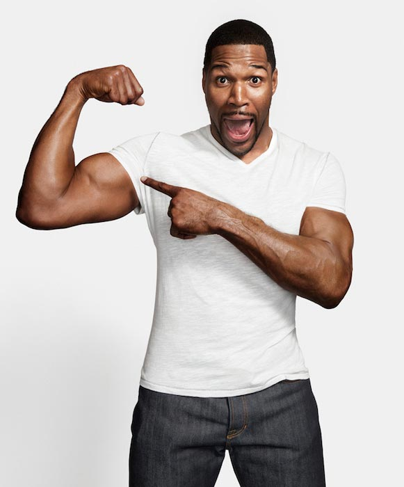 Michael Strahan showing his bicep