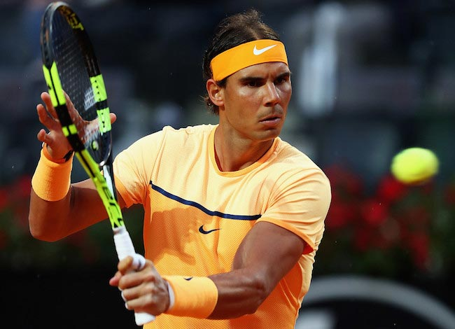 Rafael Nadal warms up for a match against Phillip Kohlscreiber during The Internazionali BNL d'Italia 2016 in Rome, Italy
