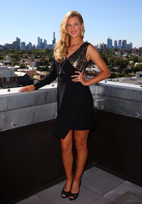 Victoria Azarenka posing in a dress