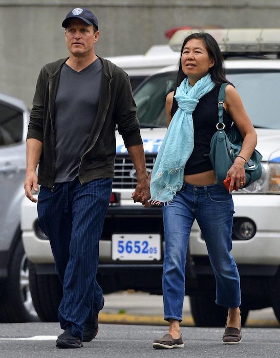 Woody Harrelson walking hand in hand with wife Laura Louie in New York City on May 22, 2013