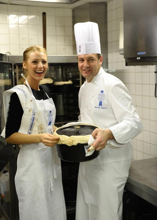 Blake Lively with a chef in kitchen