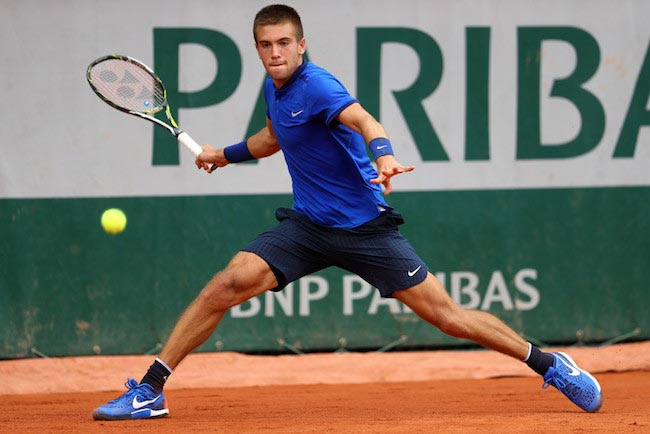 Borna Coric returns the ball against Bernard Tomic at 2016 French Open on May 26, 2016 in Paris