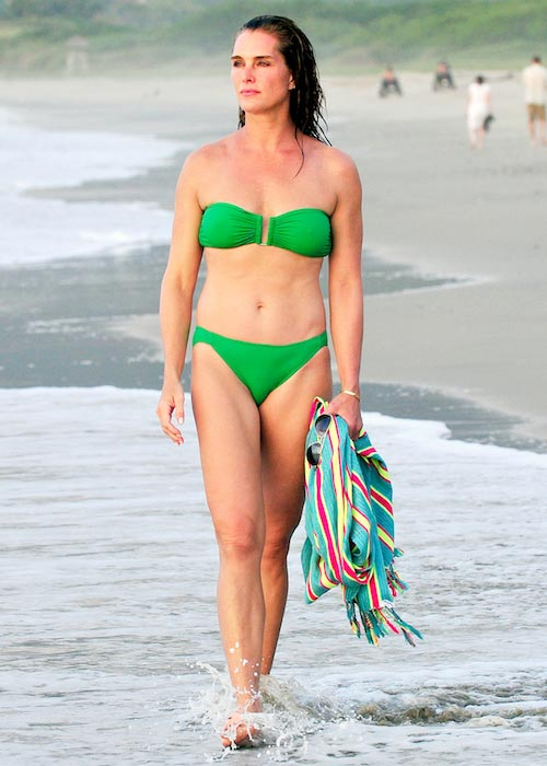 Brooke Shields reveals her flawless beach body as she takes a late afternoon stroll in the Mexican sea