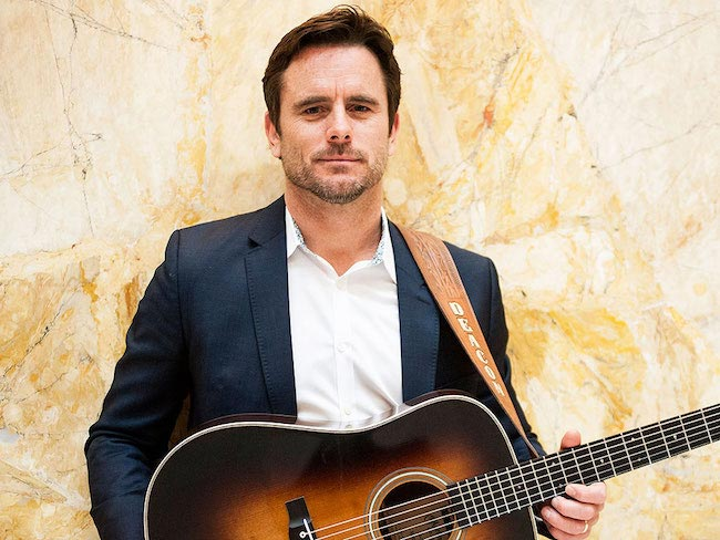 Charles Esten posing for a portrait in Union Station, Washington DC in May 2014