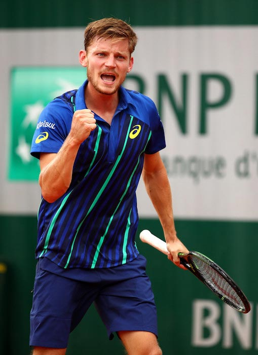 David Goffin celebrates a point in a match against Dominic Thiem at 2016 French Open on June 2, 2016