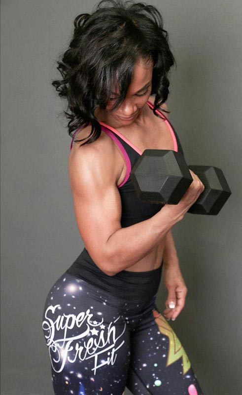 Eve Guzman doing bicep workout