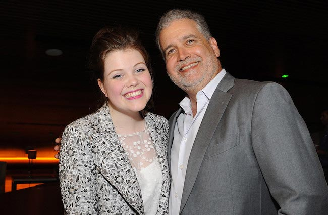 "Georgie Henley and director Stanley M. Brooks at the premiere of ""Perfect Sisters"" in April 2014"