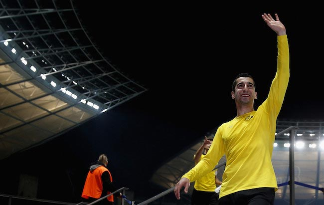 Henrikh Mkhitaryan waves to his fans after the DFB Cup semi final match against Hertha BSC on April 20, 2016
