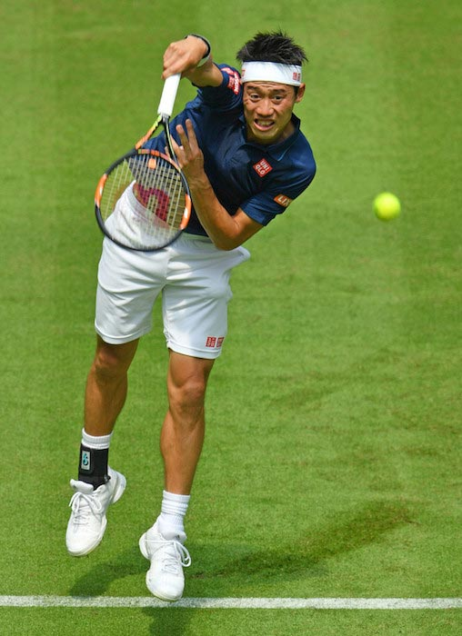 Kei Nishikori serves against Lucas Pouille in a match at Gerry Weber Open on June 13, 2016 in Halle, Germany