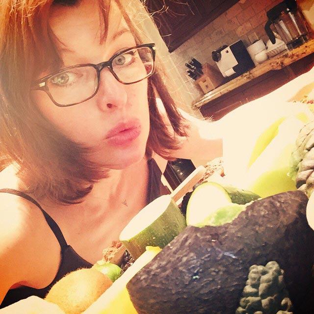 Milla Jovovich having vegetables