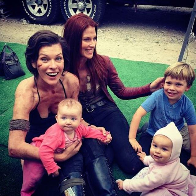 On Resident Evil set, with her younger daughter, co-star Ali Larter and her children.