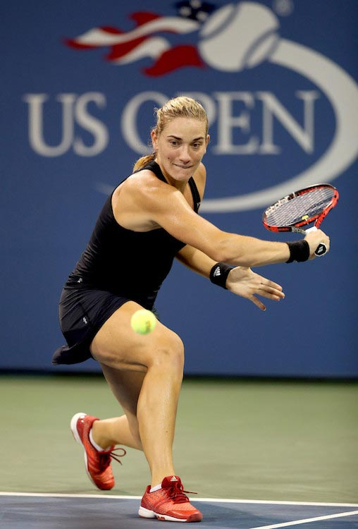 Timea Babos plays slice shot against Samantha Stosur in a match of 2015 US Open in NYC