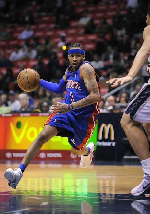 Allen Iverson in action against Brook Lopez during a match between the Detroit Pistons and New Jersey Nets on November 7, 2008