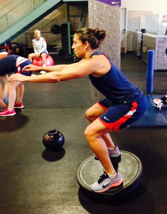 Carli Lloyd exercising in gym