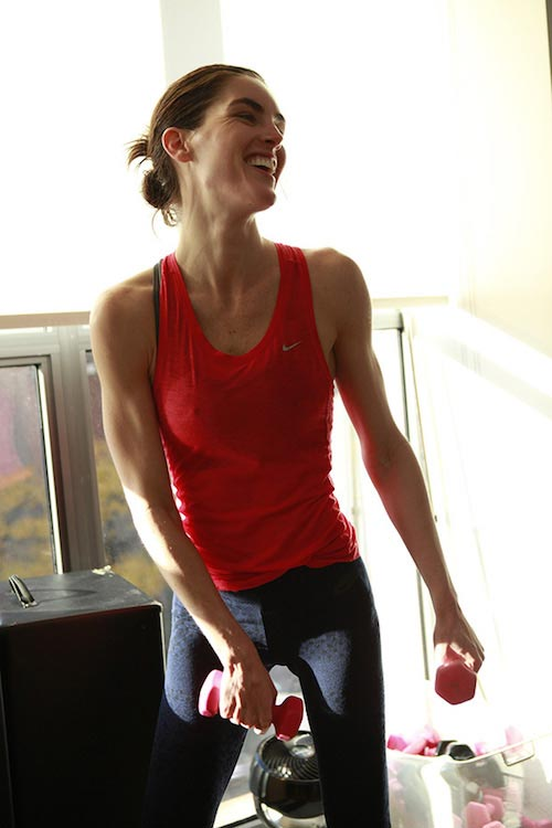 Hilary Rhoda holding dumbbells