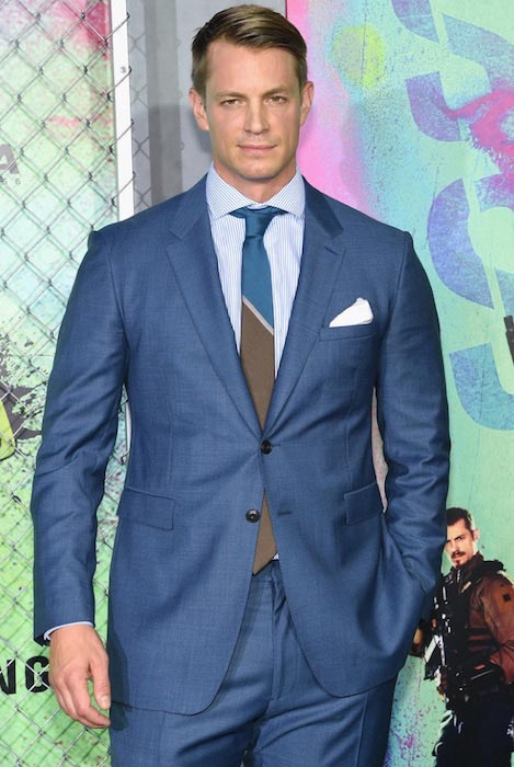 """Joel Kinnaman in a Burberry suit at """"Suicide Squad"""" premiere in NYC on August 1, 2016"""