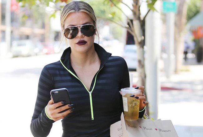 Khloe Kardashian shopping and having a drink