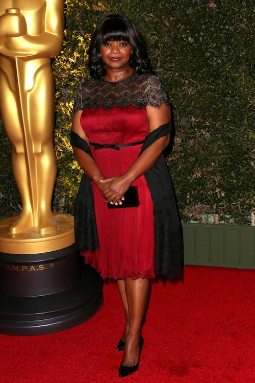 Octavia Spencer in a red cocktail dress during Governor Awards in November 2013