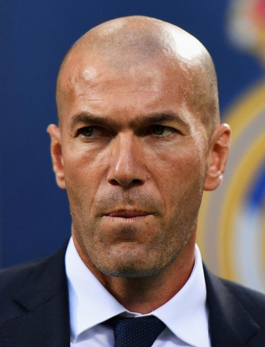Zinedine Zidane looks during the UEFA Champions League Final match between Real Madrid and Atletico Madrid on May 28, 2016 in Milan