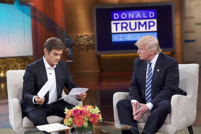 Dr Oz studying medical reports of Donald Trump