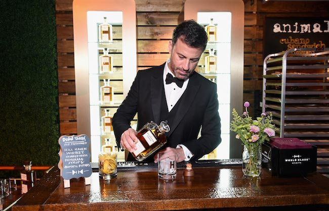Jimmy Kimmel pouring alcohol to the glass