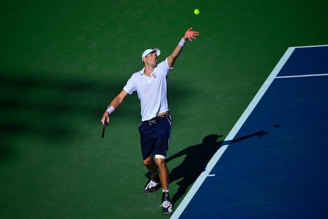 John Isner serves against Frances Tiafoe during 2016 US Open on August 29, 2016