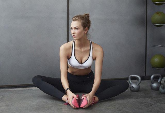 Karlie Kloss wearing leggings and sports bra
