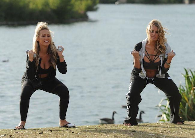 Kate Wright and Danielle Armstrong working out at a park in Essex