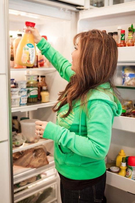 Lisa Lillien checking her fridge
