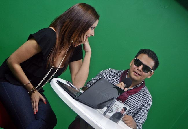Marvin Lara getting interviewed at Canal Antigua's Musicas Registradas in 2015