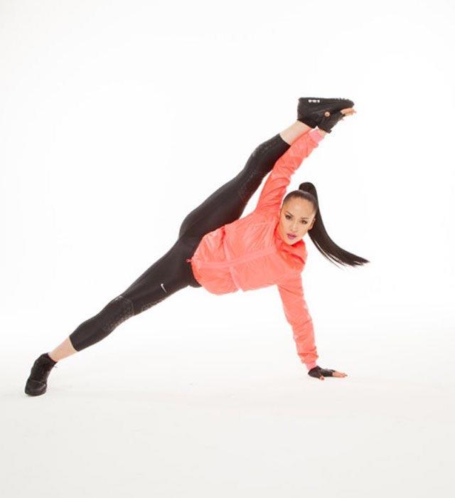 Nicole Winhoffer stretching her body