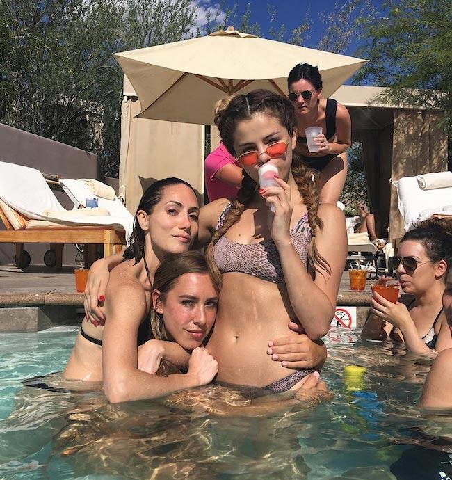 Selena Gomez with Amy Rosoff Davis in the swimming pool