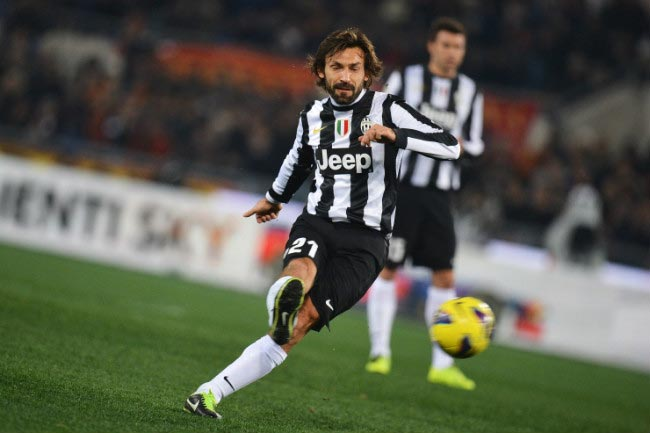 Andrea Pirlo takes a free kick in an away match against AS Roma at Stadio Olympico in February 2013