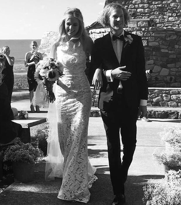 Bridget Malcolm walks down the aisle with husband Nathanial Hoho