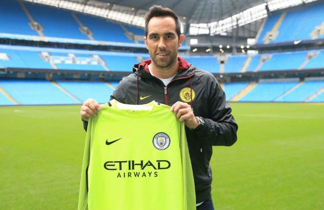 Claudio Bravo poses with the Manchester City jersey at his official unveiling at the English club on August 24, 2016