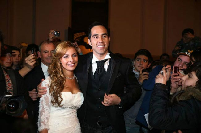 Claudio Bravo and Carlo Pardo beams for the cameras after their wedding in June 2013
