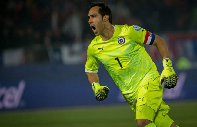 Claudio Bravo wheels away in celebration after saving a penalty in the 2015 Copa America final