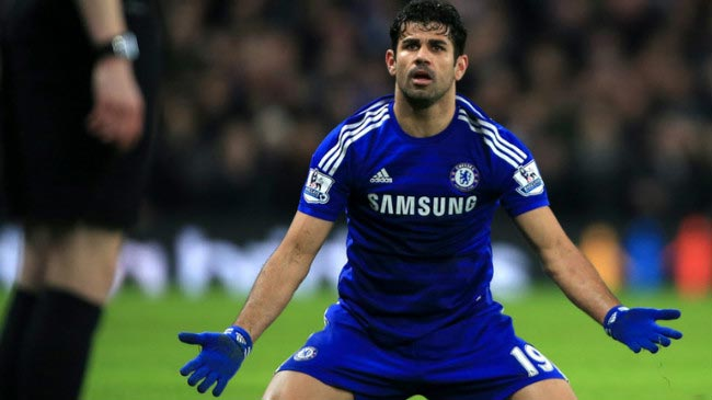 Diego Costa appeals to the referee after being fouled by the defender
