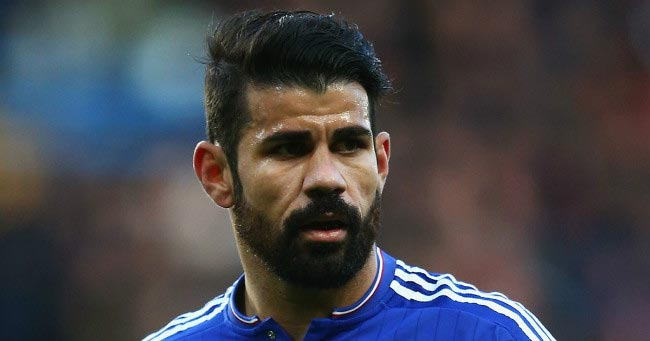 Diego Costa watches on during a home match in the EPL